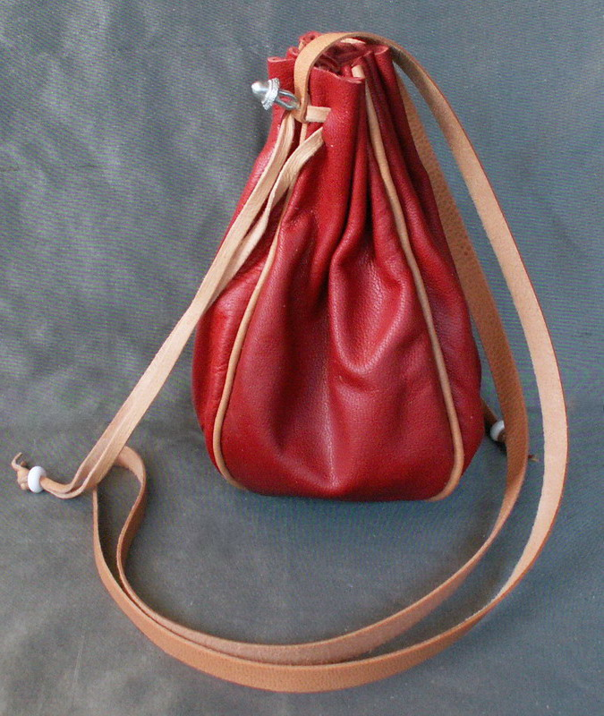 Round drawstring purse with piped seams
