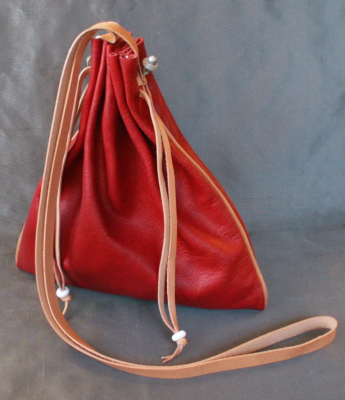 Square drawstring purse with piped seams