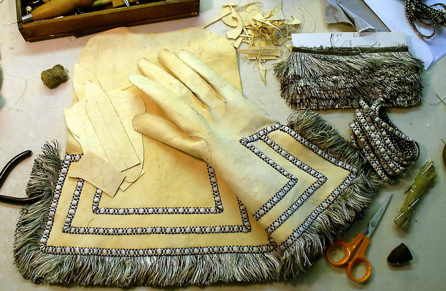 Fringed gloves being made