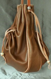 16th/17th century ladies draw string purse with a gusset, two side pockets and piped seams