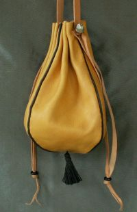 Ladies 14th/17th century round drawstring purse with piped seams and a tassel